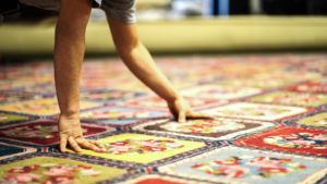 S&S Rug Cleaners' employee providing rug repair services in Atlanta