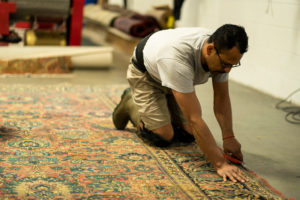 Employee S&S Rug Cleaning providing Atlanta rug repair services