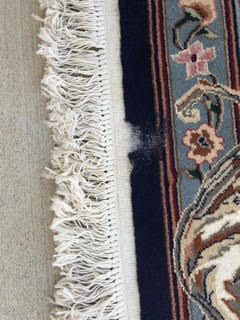 oriental rug chewed by moths